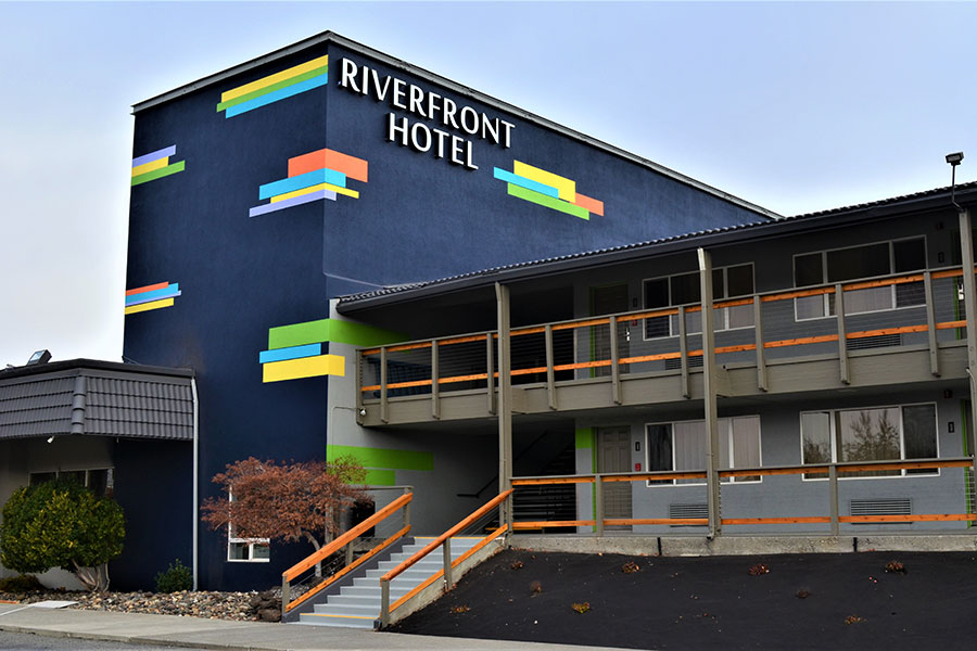 exterior of The Riverfront Hotel, SureStay Collection by Best Western